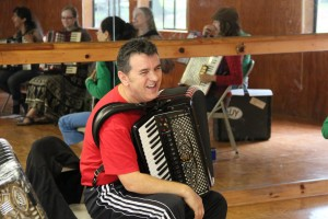 Raif pauses for a laugh during his accordion class, Iroquois Springs, 2011. (photo: Margaret Loomis)