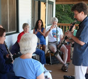 Teaching clarinet on a porch at East Coast camp.