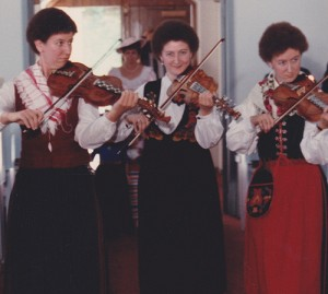 Catherine with her sisters playing Scandinavian fiddle; left to right: Elizabeth Foster, Catherine Foster and Leslie Foley. (photo courtesy Catherine Foster)