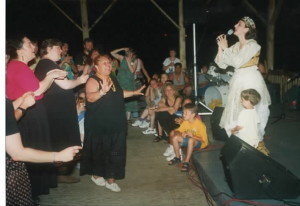 Musical communion: Esma Redžepova dances to Merita's singing at Ramblewood, 1998.